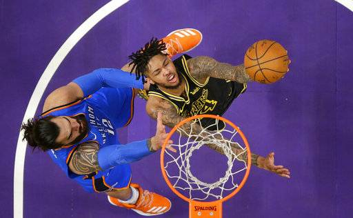 Los Angeles Lakers forward Brandon Ingram, right, shoots as Oklahoma City Thunder center Steven Adams, of New Zealand, defends during the first half of an NBA basketball game Thursday, Feb. 8, 2018, in Los Angeles.