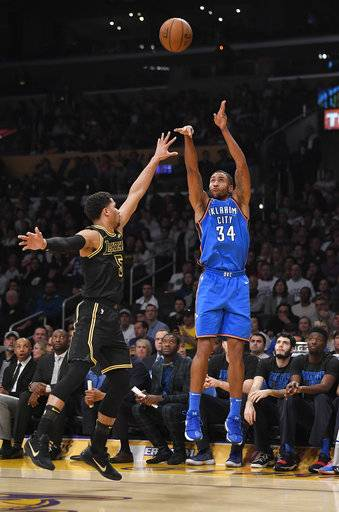 Oklahoma City Thunder forward Josh Huestis shoots as Los Angeles Lakers guard Josh Hart defends during the first half of an NBA basketball game Thursday, Feb. 8, 2018, in Los Angeles.