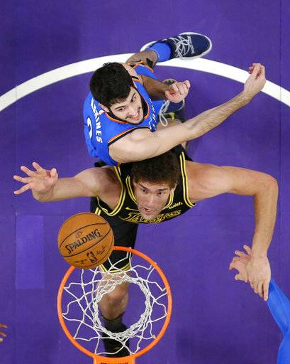 Los Angeles Lakers center Brook Lopez, below, shoots as Oklahoma City Thunder guard Alex Abrines, of Spain, defends during the first half of an NBA basketball game Thursday, Feb. 8, 2018, in Los Angeles.