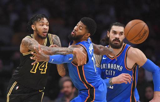 Los Angeles Lakers forward Brandon Ingram, left, passes the ball past Oklahoma City Thunder forward Paul George, center, and center Steven Adams, of New Zealand, during the first half of an NBA basketball game, Thursday, Feb. 8, 2018, in Los Angeles.
