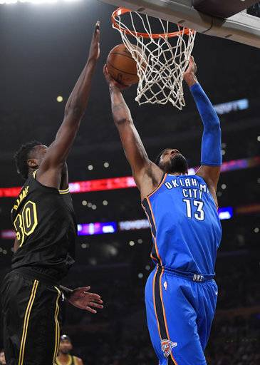 Oklahoma City Thunder forward Paul George, right, shoots as Los Angeles Lakers forward Julius Randle defends during the first half of an NBA basketball game, Thursday, Feb. 8, 2018, in Los Angeles.