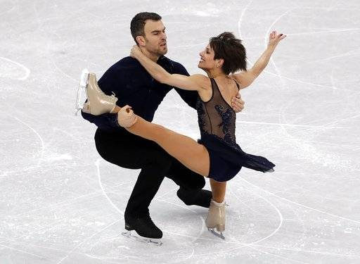 Meagan Duhamel and Eric Radford of Canada perform in the pair skating short program team event at the 2018 Winter Olympics in Gangneung, South Korea, Friday, Feb. 9, 2018.