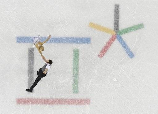 Aljona Savchenko and Bruno Massot, of Germany, perform in the pair skating short program team event at the 2018 Winter Olympics in Gangneung, South Korea, Friday, Feb. 9, 2018.