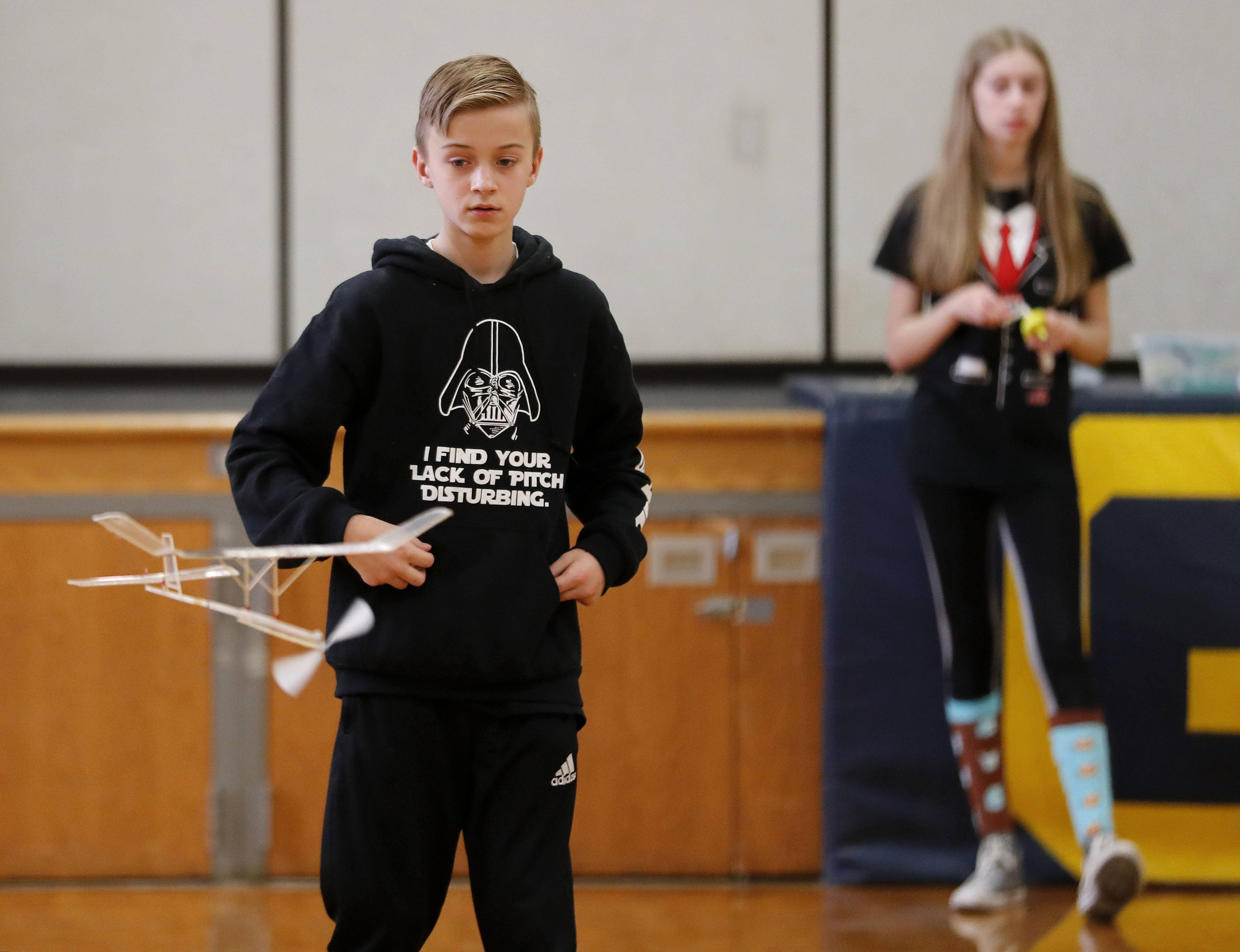 Grayslake Middle School students Leo Pietruszynski, left, and Sarah Burkinshaw put their plane through a test Saturday during the Grayslake Invitational Science Olympiad. The invitational featured 47 middle school teams from all over Illinois.
