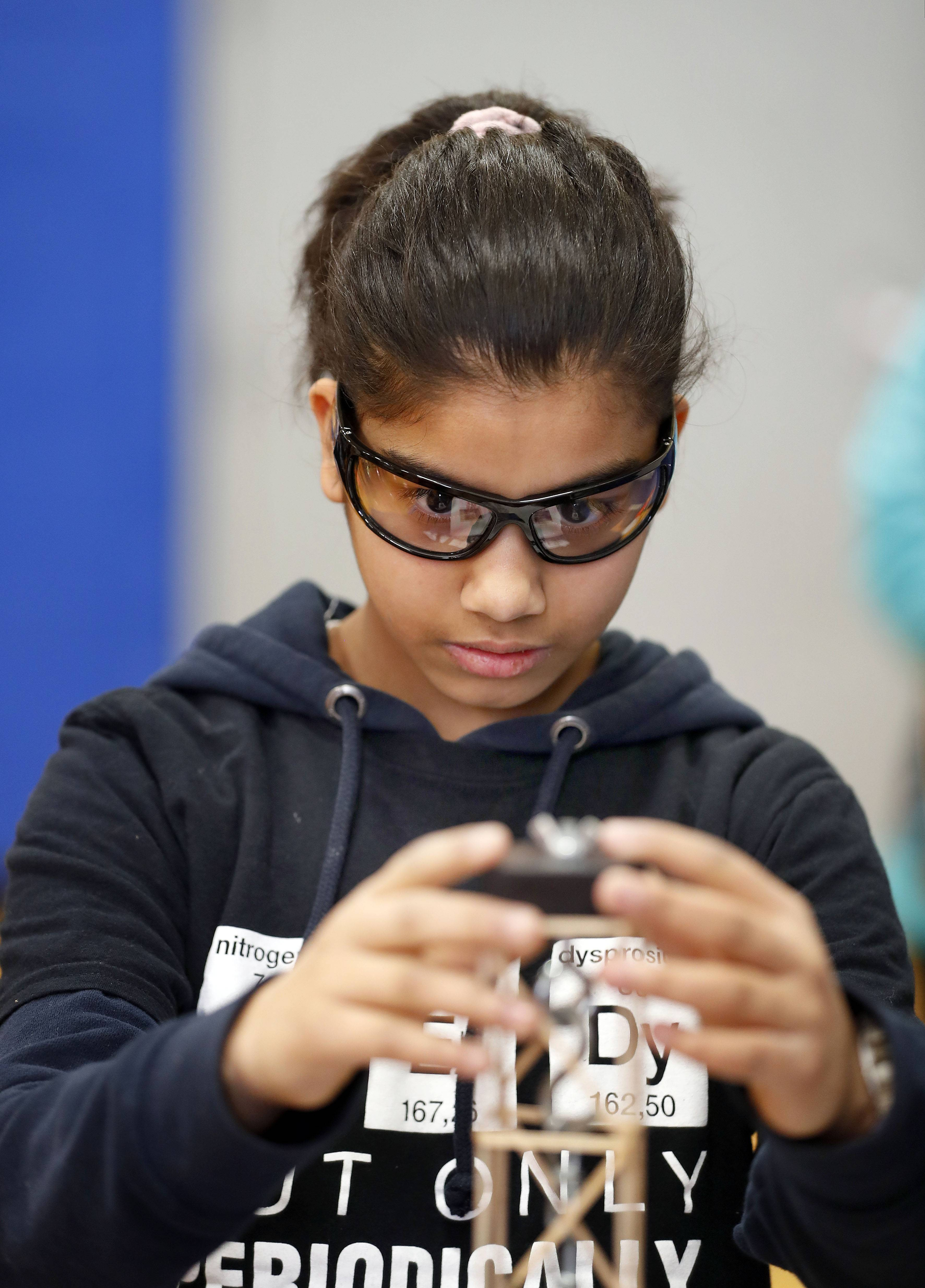 Mitya Mehta, 12, of Hawthorn Middle School North in Vernon Hills, balances her tower Saturday during the Grayslake Invitational Science Olympiad.
