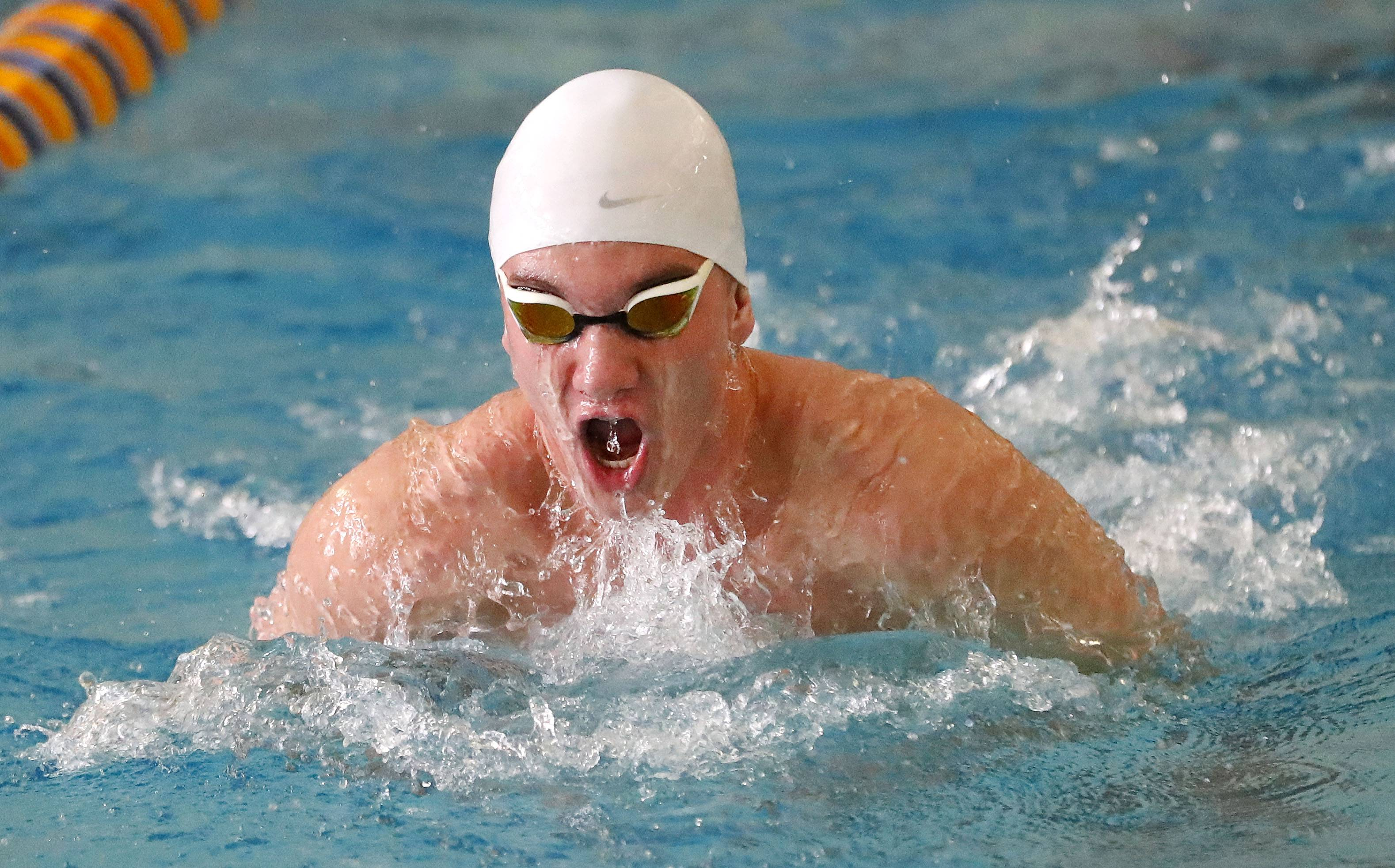 Libertyville's Billy Bennett swims in the 200 medley relay during the North Suburban Conference meet Saturday at Lake Forest.