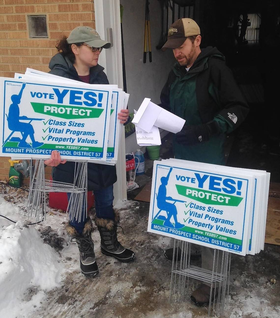 Nancy and George Vincent pick up 30 yard signs to deliver to backers of the Mount Prospect Elementary District 57 tax increase.