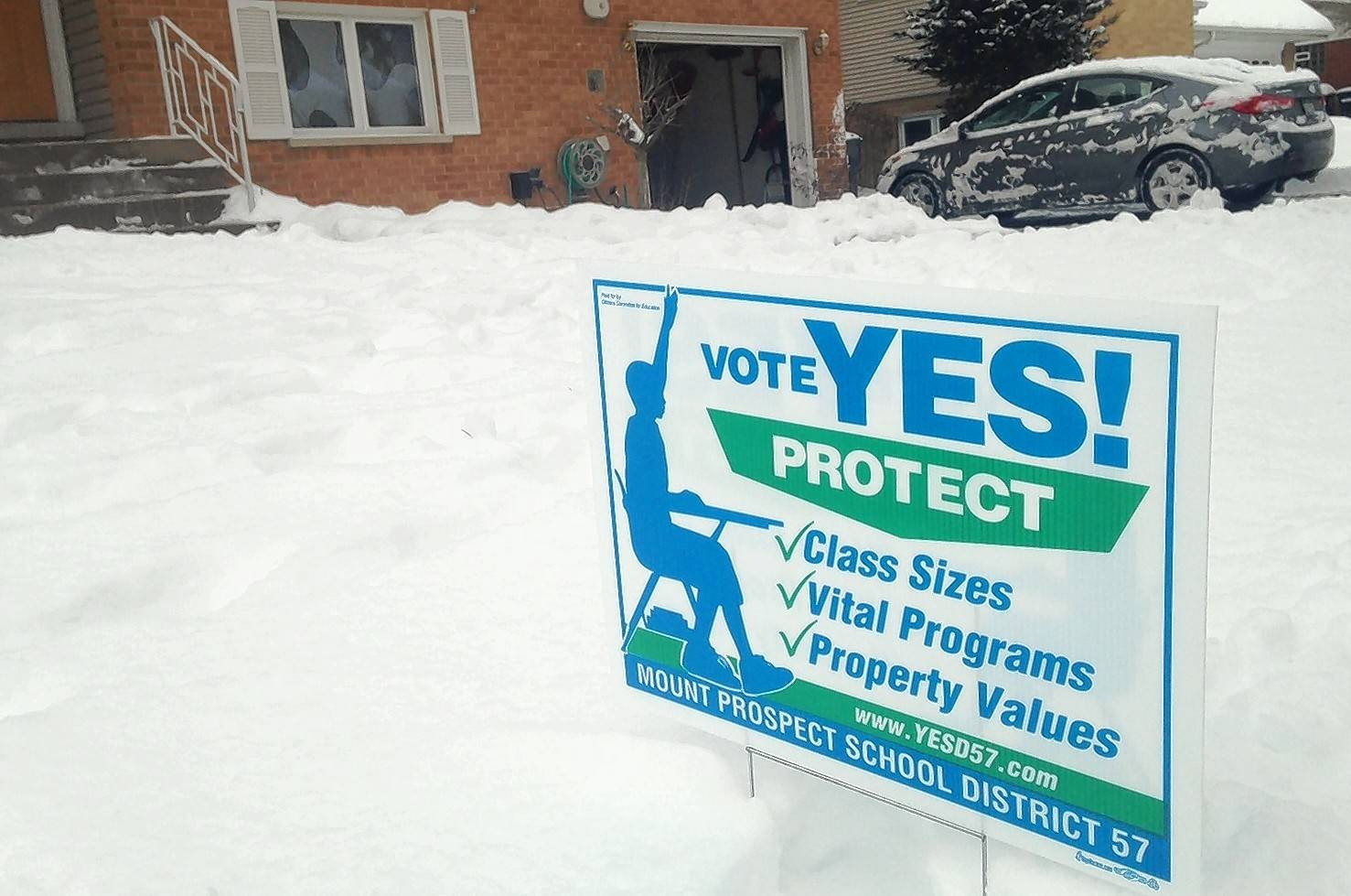 One of the signs backing the Mount Prospect Elementary District 57 tax increase is in the yard of Melissa Johnson, who was distributing the signs from her garage.