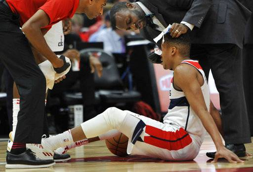 Washington Wizards' Tim Frazier received attention after being injured during the first half of the team's NBA basketball game against the Chicago Bulls on Saturday, Feb. 10, 2018, in Chicago.