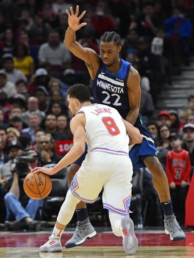 CORRECTS YEAR TO 2018 - Chicago Bulls guard Zach LaVine (8) drives to the basket as Minnesota Timberwolves forward Andrew Wiggins (22) defends during the first half of an NBA basketball game Friday, Feb. 9, 2018, in Chicago.