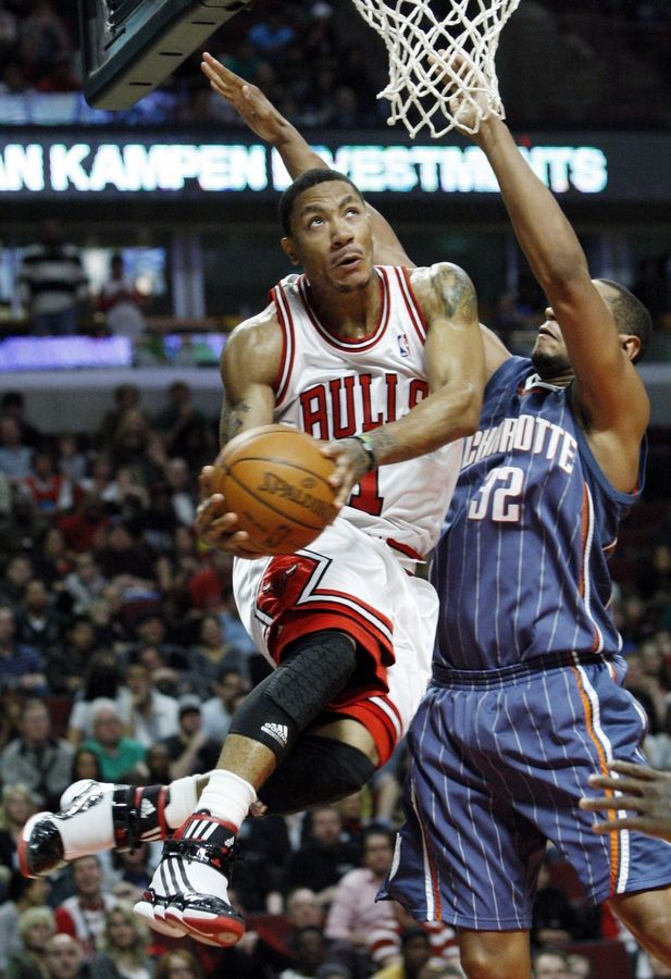 Chicago Bulls' Derrick Rose, left, drives to the basket against Charlotte Bobcats' Boris Diaw during the fourth quarter of an NBA basketball game in Chicago, Saturday, April 3, 2010. The Bulls won 96-88.