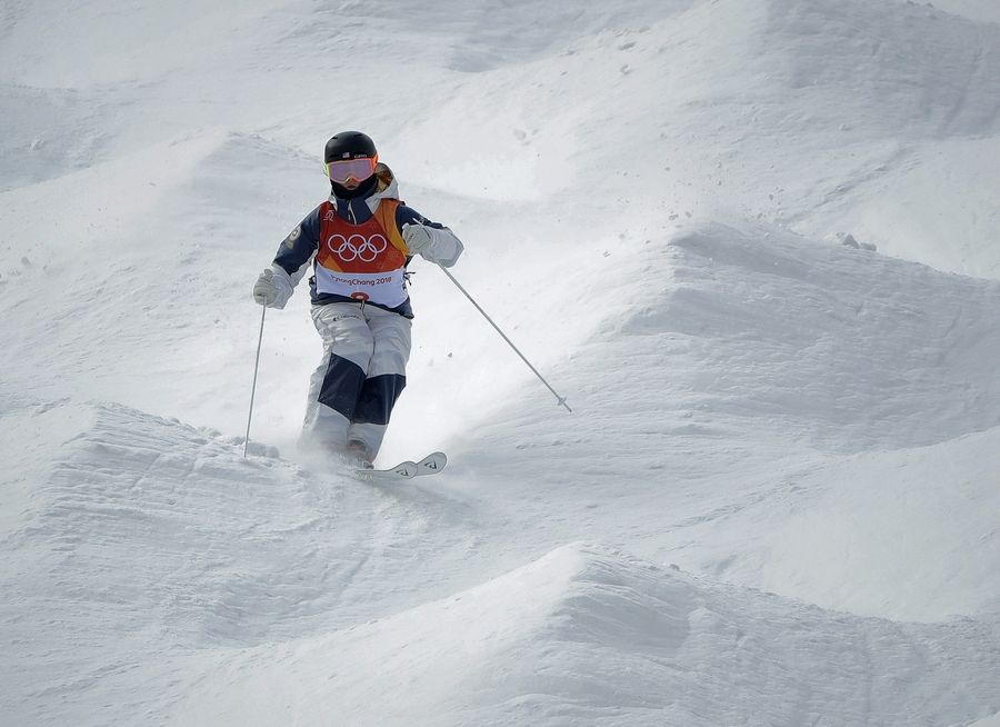 Keaton McCargo, of the United States, runs the course during the women's moguls qualifying at the 2018 Winter Olympics in Pyeongchang, South Korea, Friday, Feb. 9, 2018.