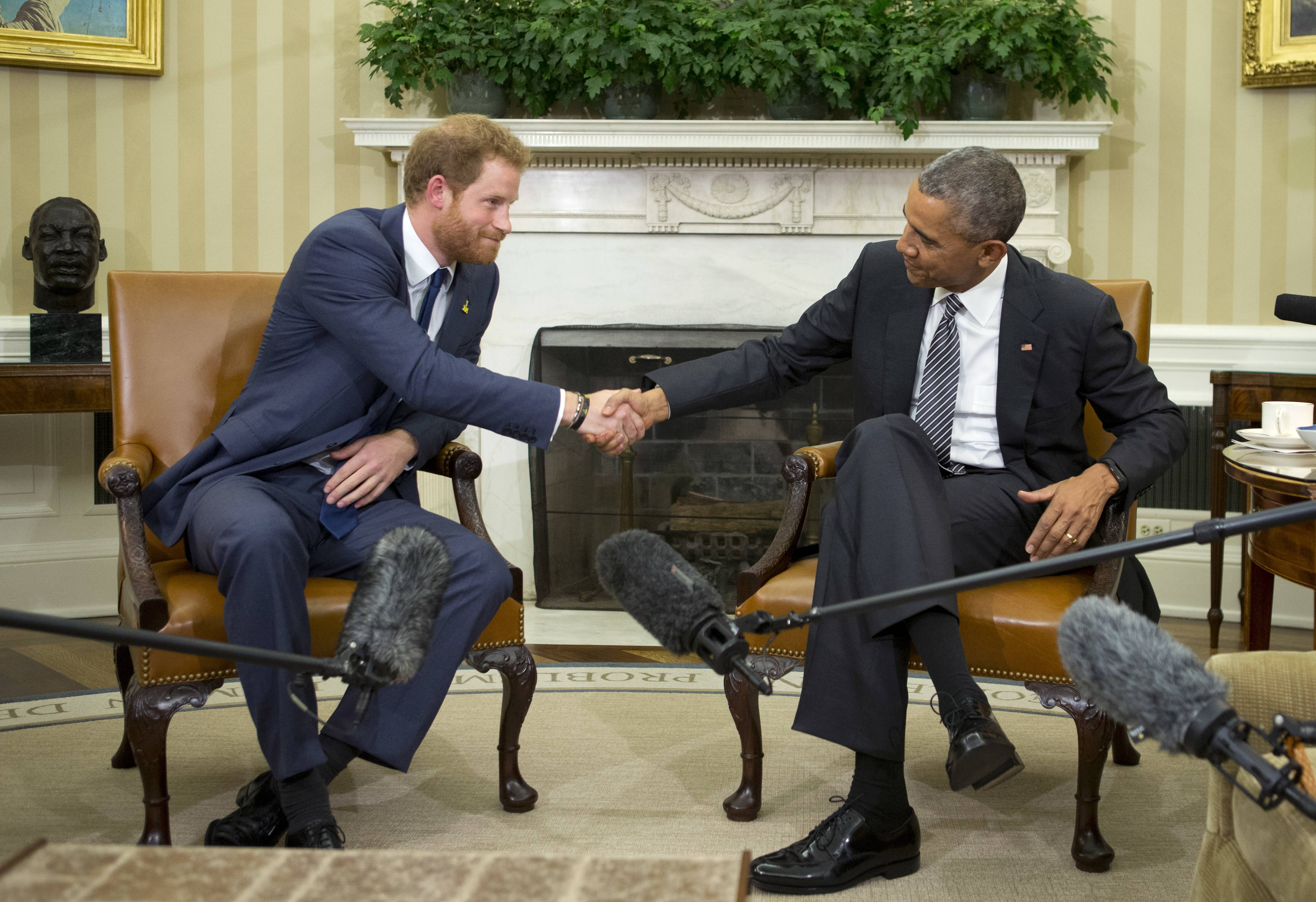 President Barack Obama, right, and Britain's Prince Harry shake hands in the Oval Office of the White House in Washington. Harry and Obama have obvious chemistry and have worked together promoting Harry's Invictus Games competition for wounded soldiers.