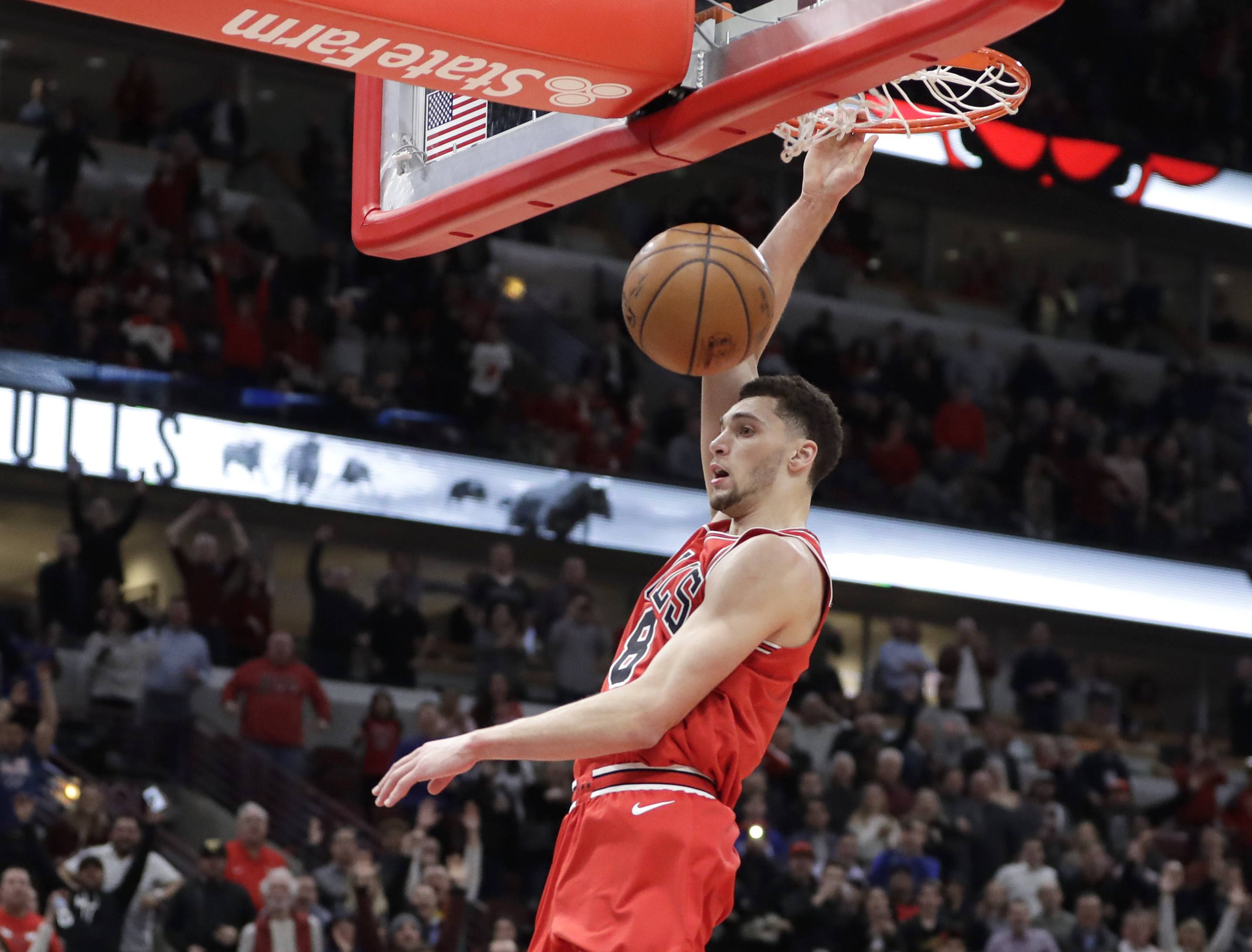 Chicago Bulls' Zach LaVine dunks the ball after stealing a pass intended for Orlando Magic's Shelvin Mack during the second half of an NBA basketball game Monday, Feb. 12, 2018, in Chicago. Bulls won 105-101.
