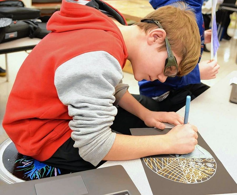 Fremont School District 79 seventh-grader Eli Fahrner works on an art project. The district recently received a grant from Healy, Bender & Associates Inc. to buy art supplies.