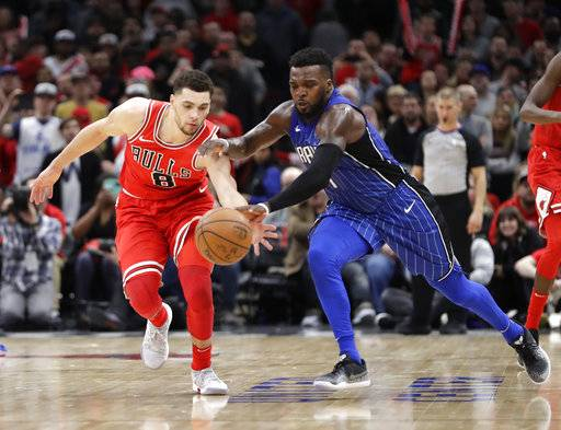 Chicago Bulls' Zach LaVine (8) steals a pass intended for Orlando Magic's Shelvin Mack during the second half of an NBA basketball game Monday, Feb. 12, 2018, in Chicago. Bulls won 105-101.