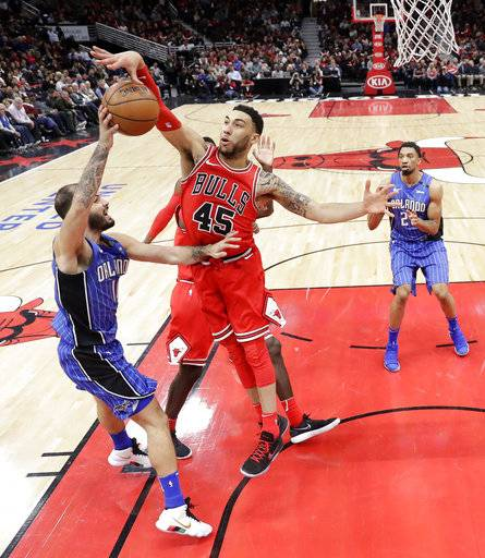Chicago Bulls' Denzel Valentine (45) blocks a pass by Orlando Magic's Evan Fournier during the second half of an NBA basketball game Monday, Feb. 12, 2018, in Chicago. Bulls won 105-101.