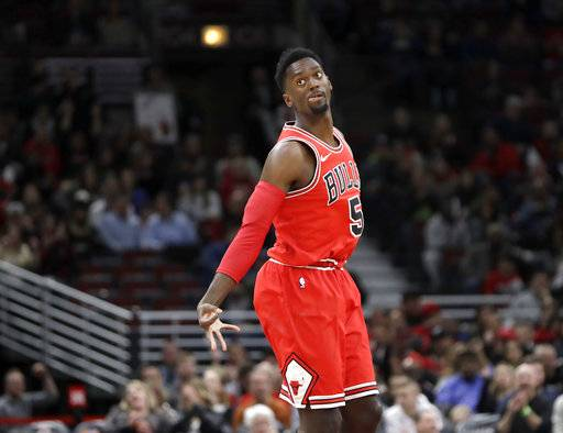 Chicago Bulls' Bobby Portis reacts after making a three-point basket during the first half of an NBA basketball game against the Orlando Magic Monday, Feb. 12, 2018, in Chicago.
