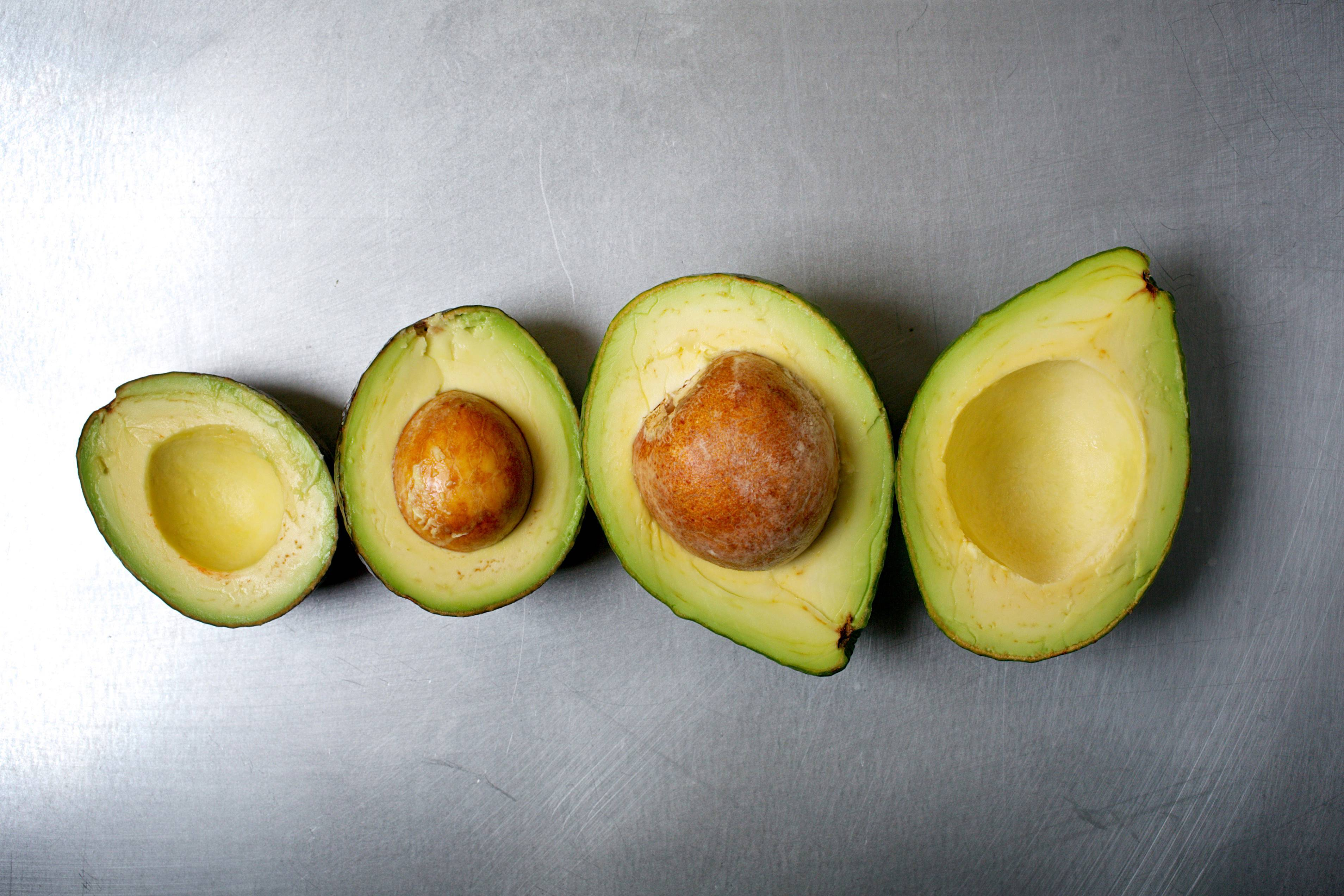"The Hass avocado, left, is the variety you're used to seeing in grocery stores. The slightly larger ""SlimCado,"" right, isn't necessarily more slimming, but it's still worth trying."