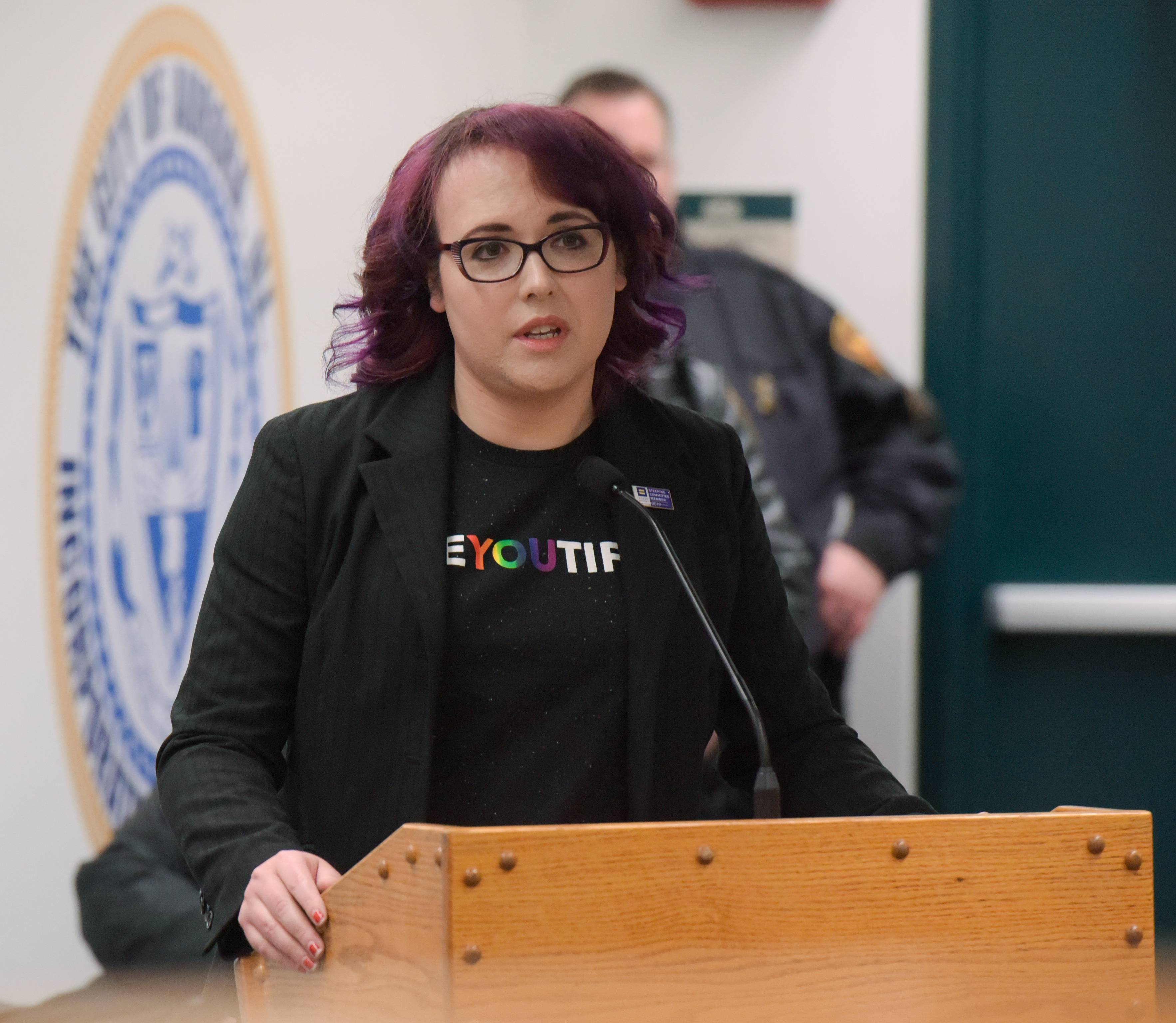 "Penelope Garcia of Aurora, who is transgender, speaks Tuesday before the Aurora Government Operations committee voted to approve the Aurora Pride Parade, set for June 17. ""Love here, the day before Valentine's Day, is greater than any kind of fear or hate that can come,"" Garcia said."