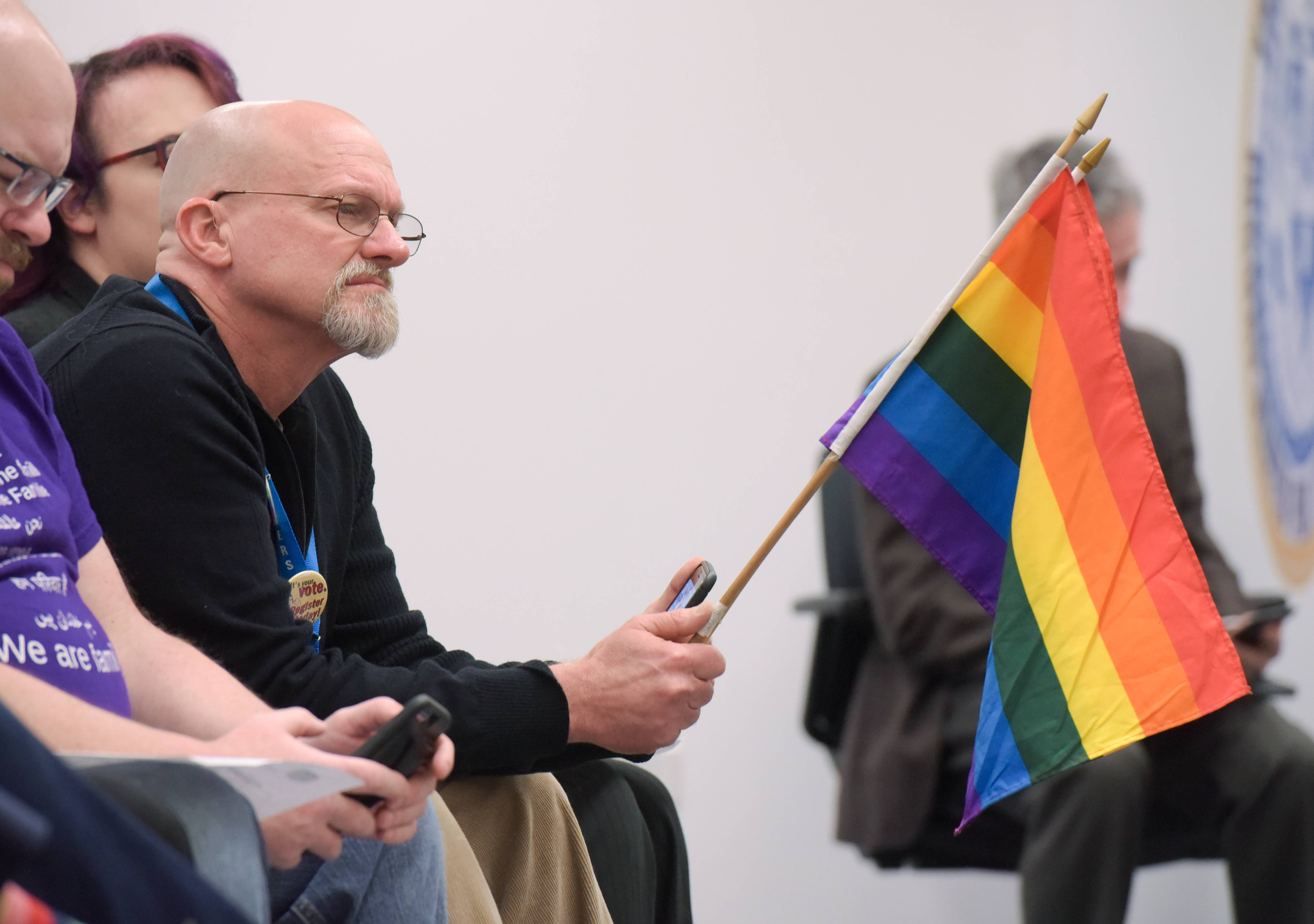 Greg Elsbree of Aurora holds a pride flag Tuesday as he supported the first Aurora Pride Parade. The parade was granted a permit and is set to step off at 1 p.m. Sunday, June 17, in downtown Aurora.