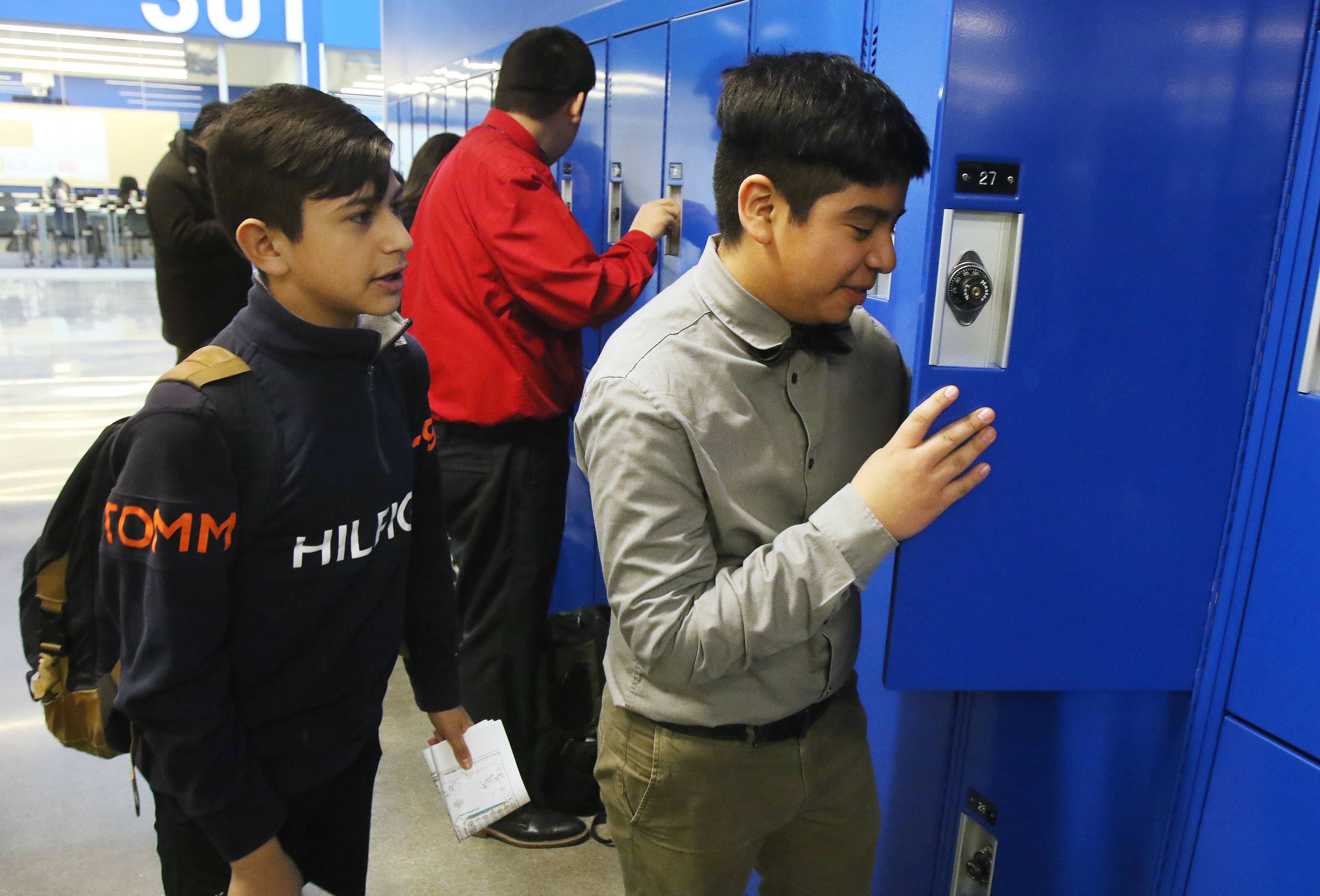 Freshman Jeremy Estrada, right, and Manuel Gallegos check out their new lockers during the first day of classes in Cristo Rey St. Martin College Prep new home in Waukegan. The building was transformed from a vacant Kmart big box store.