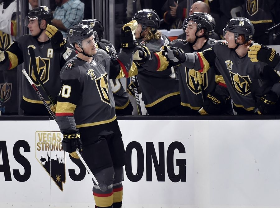 Vegas Golden Knights center Ryan Carpenter (40) celebrates with his team after scoring against the Chicago Blackhawks during the first period of an NHL hockey game Tuesday, Feb. 13, 2018, in Las Vegas.