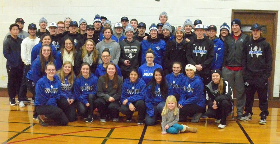 Aurora University baseball and softball student athletes pose for a photo at Wayside Cross Ministries' after Waysides' Walk a Mile in My Shoes benefit walk was canceled due to the Feb. 9 winter storm.
