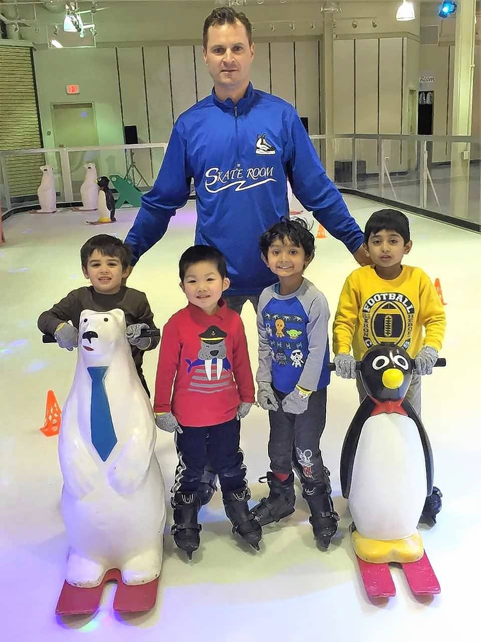 Vernon Hills Montessori Academy students Ethan Boulanger, left, Leo Sze, Vihaan Vyas, and Aryan Deshmukh, learn to ice skate with the help of Kevin Jotkus, owner of the Skate Room skating rink in Hawthorn Mall in Vernon Hills.