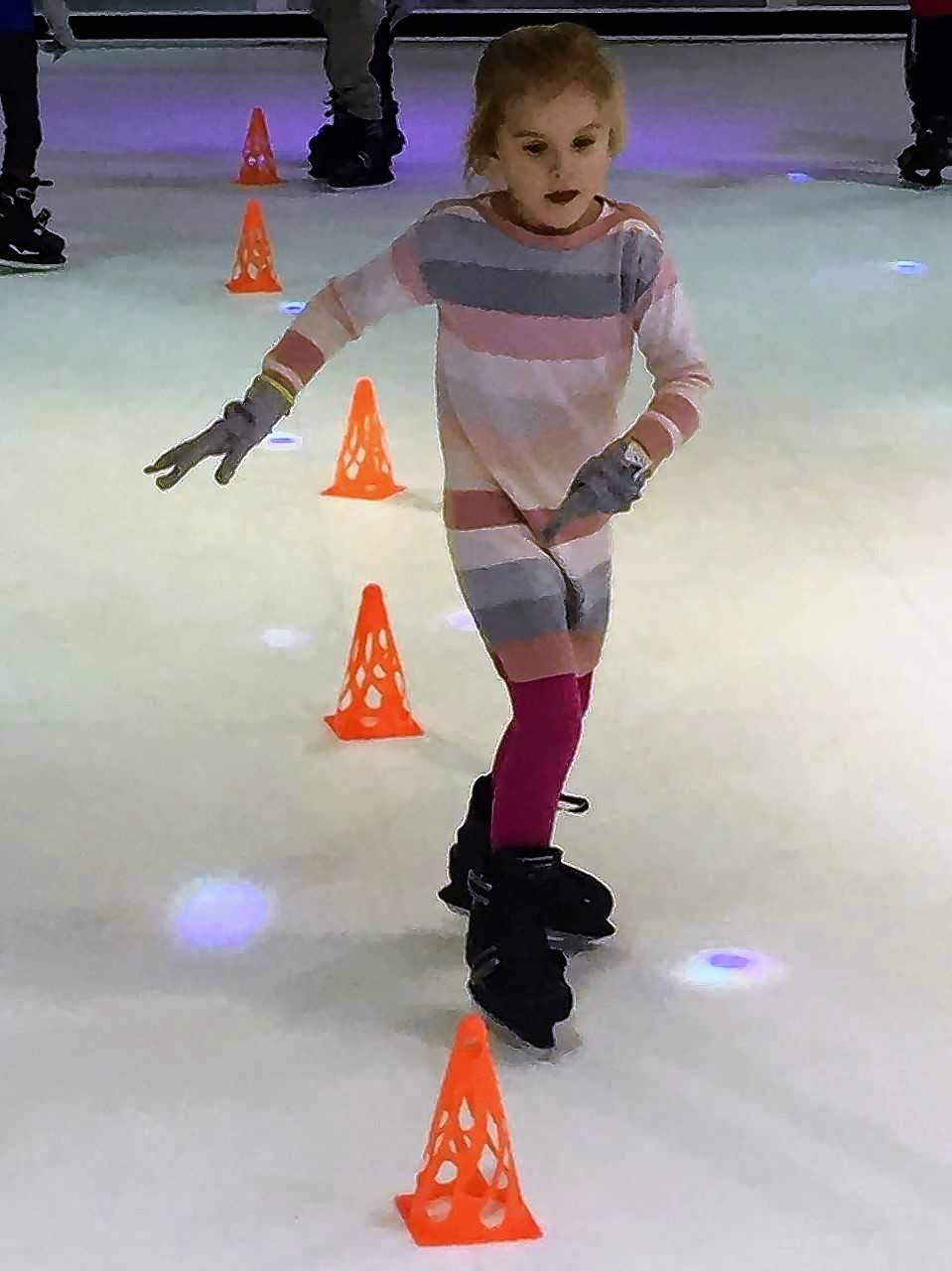 Vernon Hills Montessori Academy student Penny Zawadzki navigates the new Skate Room ice skating rink in Hawthorn Mall in Vernon Hills. The rink uses synthetic ice tiles instead of traditional ice.
