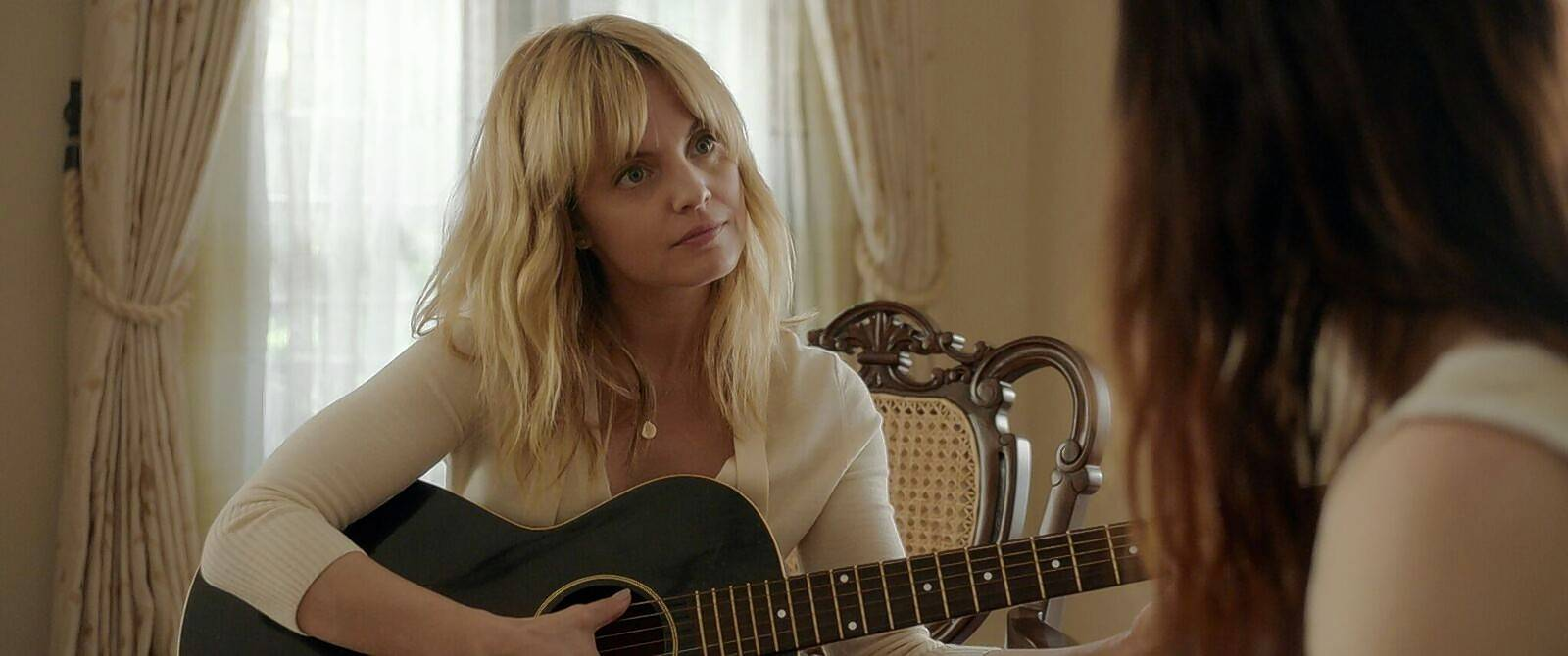 "There is more than guitar lessons at stake when a housewife, played by Mena Suvari, hooks up with a singer/songwriter played by Lena Hall in ""Becks,"" a movie based on the life of Arlington Heights native Alyssa Robbins."