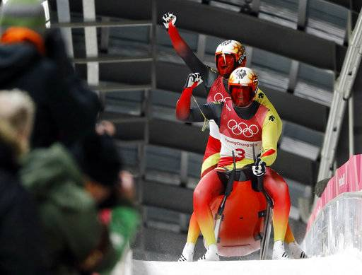 Tobias Arlt and Tobias Wendl of Germany celebrate theor gold medal winning run during the men's doubles luge final at the 2018 Winter Olympics in Pyeongchang, South Korea, Wednesday, Feb. 14, 2018.