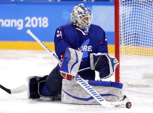 South Korea's goalie Shin So-jung (31), of the combined Koreas team, deflects the puck during the second period of the preliminary round of the women's hockey game against Sweden at the 2018 Winter Olympics in Gangneung, South Korea, Monday, Feb. 12, 2018.