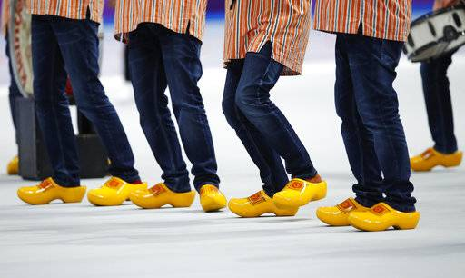 The members of the Dutch marching band Kleintje Pils, or Small Beer, dance on wooden shoes as they entertain the spectators prior to the women's 1,500 meters speedskating race at the Gangneung Oval at the 2018 Winter Olympics in Gangneung, South Korea, Monday, Feb. 12, 2018.