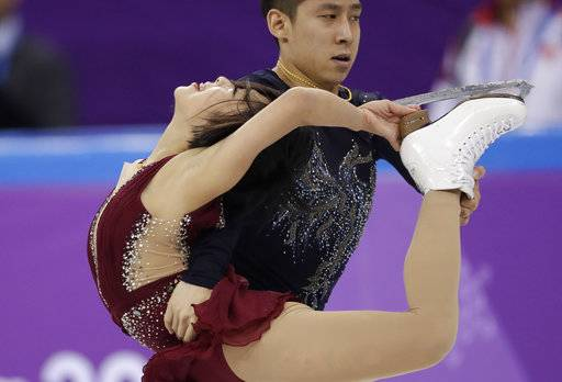 Sui Wenjing and Han Cong of China perform in the pair figure skating short program in the Gangneung Ice Arena at the 2018 Winter Olympics in Gangneung, South Korea, Wednesday, Feb. 14, 2018.