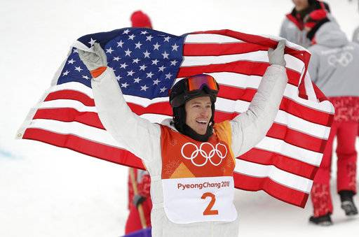 Shaun White, of the United States, celebrates winning gold after his run during the men's halfpipe finals at Phoenix Snow Park at the 2018 Winter Olympics in Pyeongchang, South Korea, Wednesday, Feb. 14, 2018.