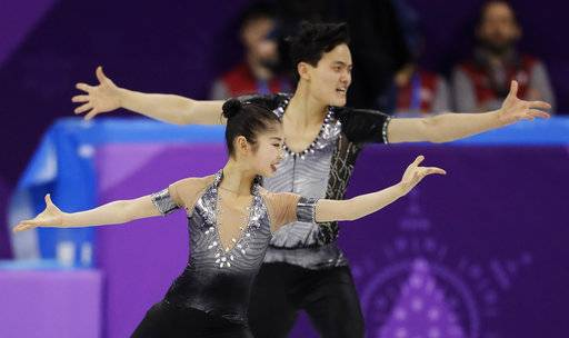 Ryom Tae Ok and Kim Ju Sik of North Korea perform in the pair figure skating short program in the Gangneung Ice Arena at the 2018 Winter Olympics in Gangneung, South Korea, Wednesday, Feb. 14, 2018.