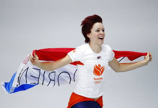 Gold medallist Jorien ter Mors of The Netherlands celebrates with the national flag after the women's 1,000 meters speedskating race at the Gangneung Oval at the 2018 Winter Olympics in Gangneung, South Korea, Wednesday, Feb. 14, 2018.