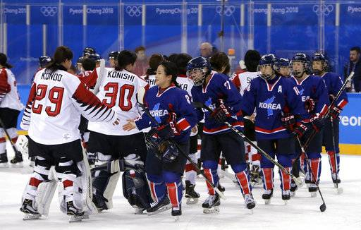 Players greet each other after the preliminary round of the women's hockey game between Japan and the combined Koreas at the 2018 Winter Olympics in Gangneung, South Korea, Wednesday, Feb. 14, 2018. Japan won 4-1.