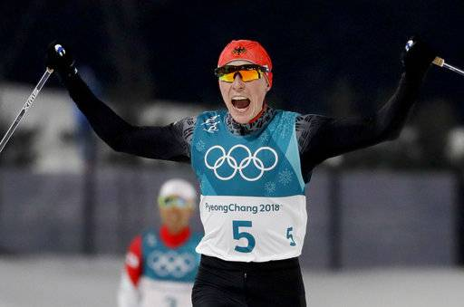 Eric Frenzel, of Germany, celebrates after winning the the gold medal after the 10km cross-country skiing portion of the nordic combined event at the 2018 Winter Olympics in Pyeongchang, South Korea, Wednesday, Feb. 14, 2018.