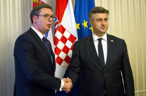 Serbia's president Aleksandar Vucic, left, is welcomed by Croatian prime minister Andrej Plenkovic, in Zagreb, Croatia, Monday, Feb. 12, 2018. President Vucic is on a two day state visit to Croatia.