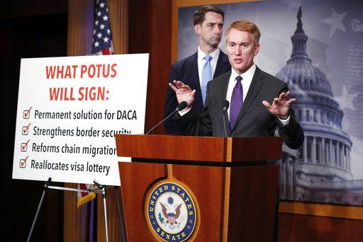 Sen. Tom Cotton, R-Ark., stands at left as Sen. James Lankford, R-Okla., speaks during a news conference about an immigration bill on Capitol Hill, Monday, Feb. 12, 2018 in Washington.
