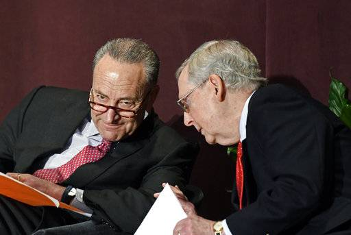 Senate Minority Leader Charles Schumer, D-N.Y., left, talks with Senate Majority Leader Mitch McConnell, R-Ky., before his speech at the McConnell Center's Distinguished Speaker Series Monday, Feb. 12, 2018, in Louisville, Ky.