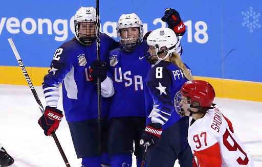 Jocelyne Lamoureux-Davidson, center, celebrates with Kelly Pannek, left, and Emily Pfalzer, of the United States, after scoring a goal during the second period of the preliminary round of the women's hockey game at the 2018 Winter Olympics in Gangneung, South Korea, Tuesday, Feb. 13, 2018.