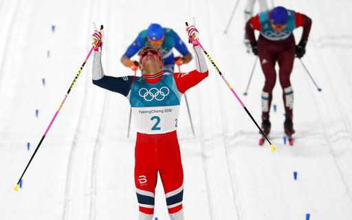 Johannes Hoesflot Klaebo, of Norway, celebrates after winning the men's cross-country skiing sprint classic at the 2018 Winter Olympics in Pyeongchang, South Korea, Tuesday, Feb. 13, 2018.