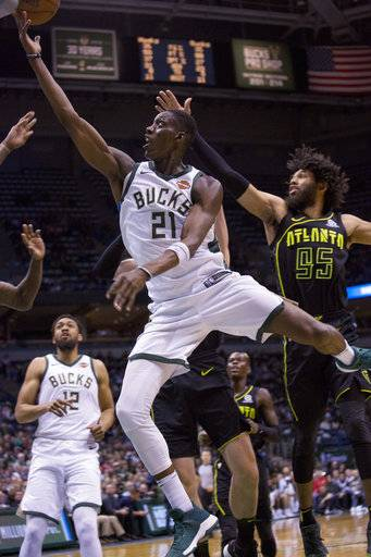 Milwaukee Bucks guard Tony Snell, center, goes up for a basket against the Atlanta Hawks during the first half of an NBA basketball game Tuesday, Feb. 13, 2018, in Milwaukee.