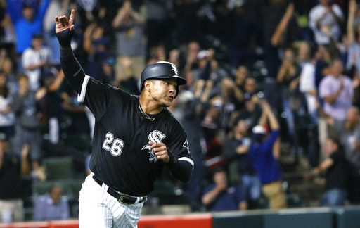 FILE - In this Aug. 23, 2017, file photo, Chicago White Sox's Avisail Garcia celebrates after scoring the game-winning run on a single by Tim Anderson during the ninth inning of a baseball game against the Minnesota Twins, in Chicago. Chicago White Sox outfielder Avisail Garcia is ging to salary arbitration. Garcia requested a hike from $3 million to $6.7 million rather than Chicago's $5.85 million offer.