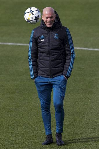 Real Madrid's head coach Zinedine Zidane smiles during a training session in Madrid, Spain, Tuesday Feb. 13, 2018. Real Madrid will play Paris Saint Germain Wednesday in a Round of 16, 1st leg Champions League soccer match.