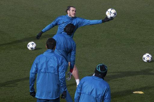 Real Madrid's Gareth Bale catches a ball during a training session in Madrid, Spain, Tuesday Feb. 13, 2018. Real Madrid will play Paris Saint Germain Wednesday in a Round of 16, 1st leg Champions League soccer match.