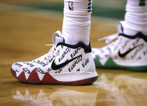 "FILE - In this Jan. 16, 2018, file photo, the word ""Equality"" adorns the athletic shoes worn by Boston Celtics guard Kyrie Irving during the second half of an NBA basketball game in Boston. Sneaker enthusiasts around the world eagerly await NBA All-Star weekend when new and limited editions of the latest shoes make their debut, but the month leading up to highly anticipated shoe palooza is a time often used to make a social statement."